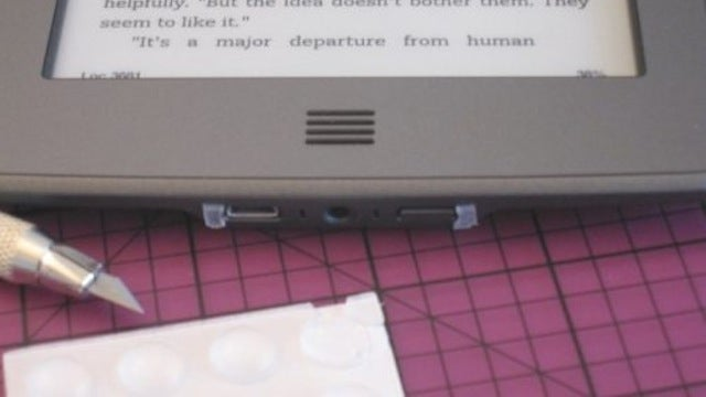 Hack Your Kindle Touch to Stand On End Without Powering Off
