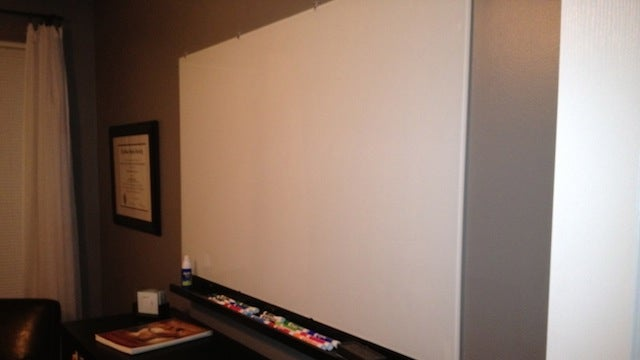 this diy glass whiteboard turns a whole wall into a space for creativity. Black Bedroom Furniture Sets. Home Design Ideas