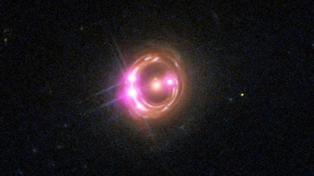 Distant supermassive black hole spins at half the speed of light