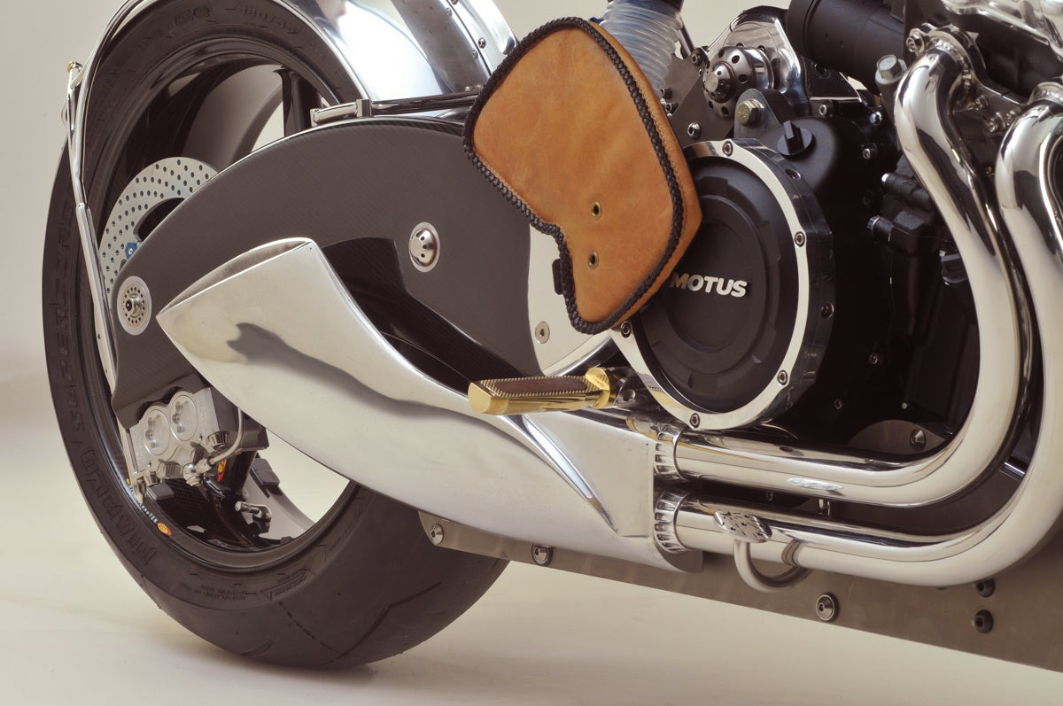 Bienville Motus engine, footpeg, and leather heat pad.