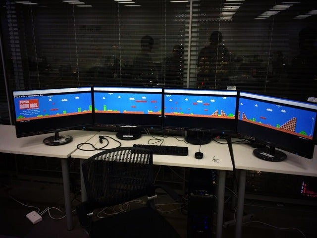 Super Mario Bros. on Four Computer Monitors