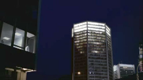 Mob Takes Over Office Lighting To Transform Tower Into Giant Frosty Pint