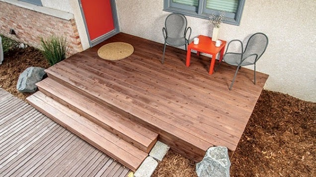 Build a front deck over your concrete stairs for added for Best builders workshop deck