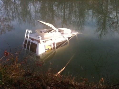 News Van Takes Dip In The River