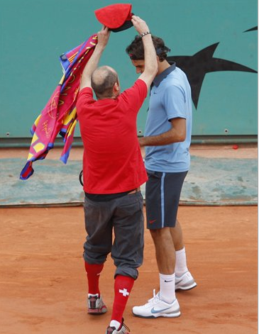 Barca Loon Attempts To Rattle Federer With Annoying Flag-To-The-Face Taunt
