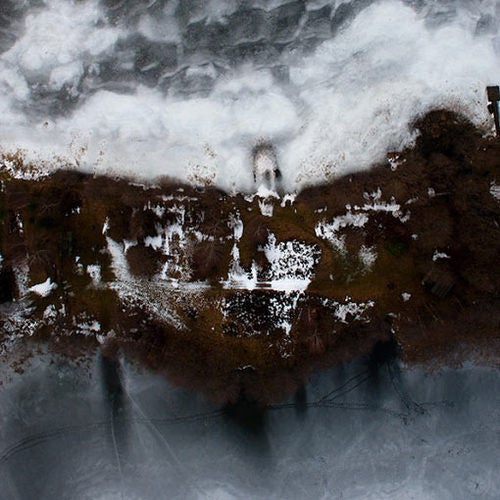 Otherworldly Winter Photos Captured Dangerously - While Paragliding