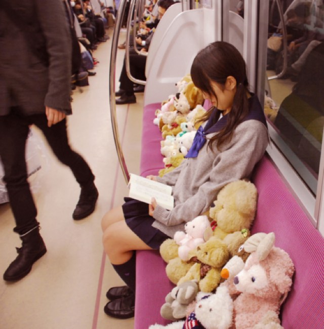 Schoolgirl Hogs Subway Seats with Her Furry Friends