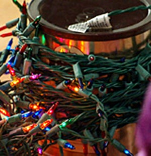 Wrap Christmas Lights Around a Coffee Can to Keep Them Organized and Untangled for Next Year