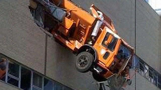 Huge Truck Rams Out of Building's Top Floor in New York