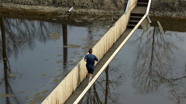 Sunken Pedestrian Bridge Parts The Waters Without a Miracle