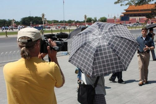 Chinese Cops Block Cameras With Umbrellas On Tiananmen Square 20th Anniversary