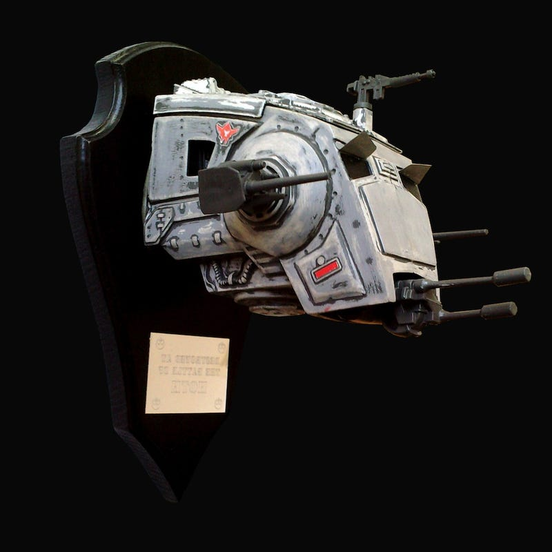 Taxidermied AT-ST trophies commemorate the Battles of Hoth and Endor