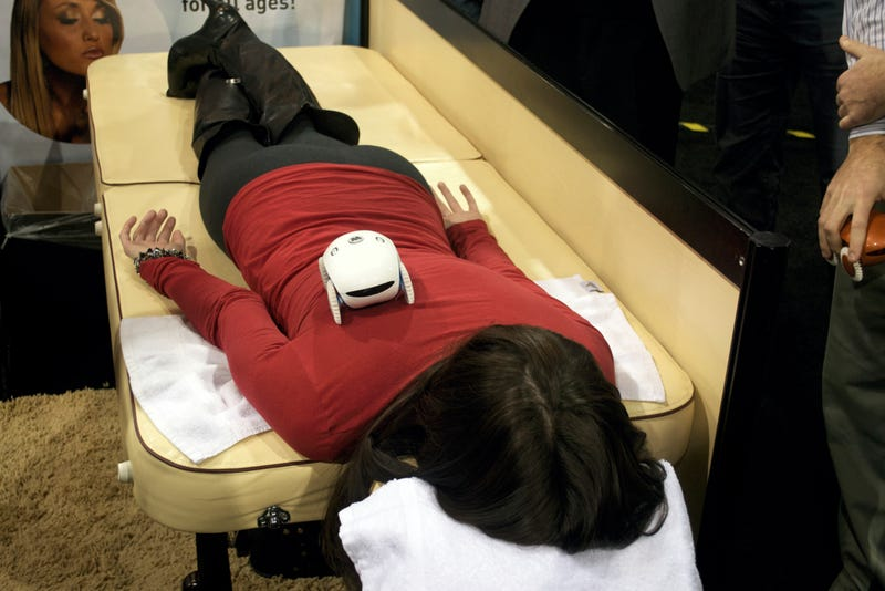 CES Caption Contest: What's Going Through this Woman's Mind as She's Massaged by a Robot?