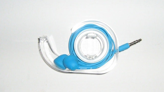 Wrap Headphones Inside an Old Tape Dispenser for Tangle-Free Storage