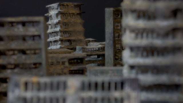 Mold-covered model buildings imagine a ghostly end of the world