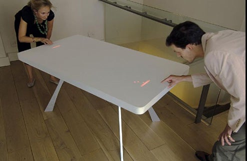 Dining Table Recreates Pong With 2,400 LEDs and 2 Trackpads