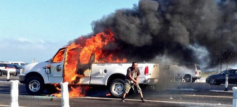 Watch This Maniac Torch His Truck And Dance Around It In Traffic