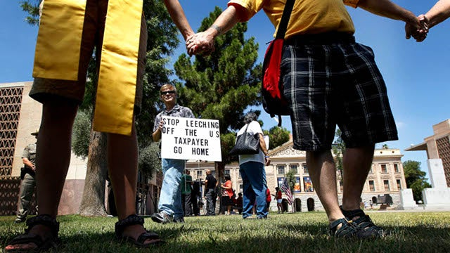 Supreme Court Rejects Some of Arizona's Immigration Law, Leaves in Pesky 'Show Me Your Papers' Clause