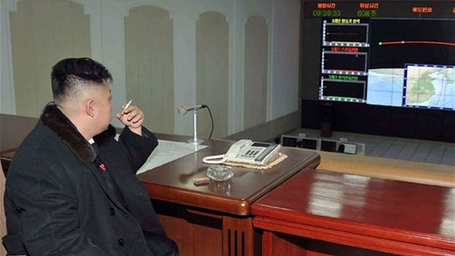 North Korea's Kim Jong-un celebrates rocket launch with a smoke