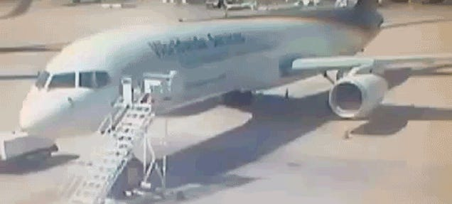 Truck Driver Somehow Crashes Into Parked Plane On Video