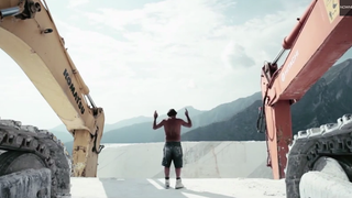 Watch a Man Direct Marble Quarry Excavators With Subtle Hand Gestures