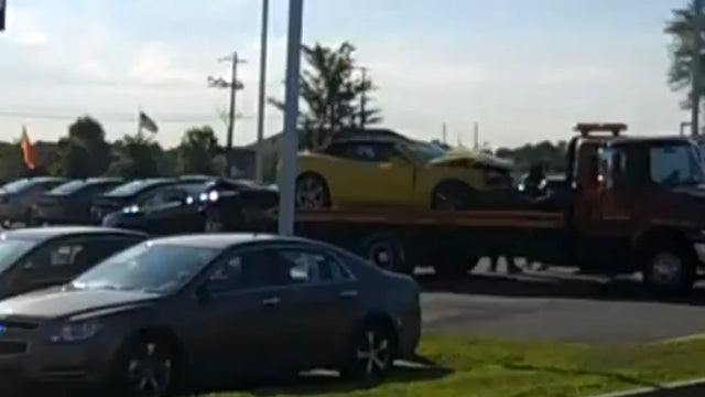 State trooper crashes into a new car dealership