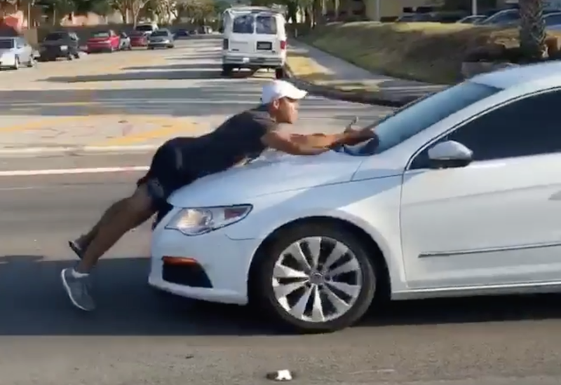 Man Carries Out Road-Rage Argument On Hood Of Another Car