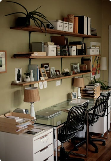 Green Walls and Wooden Shelves: The Natural Workspace for Two