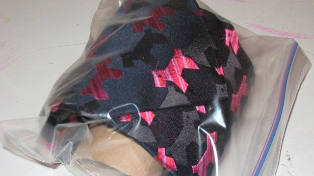 Use a Toilet Paper Roll and a Sandwich Bag to Protect Your Ties at Home or On The Road