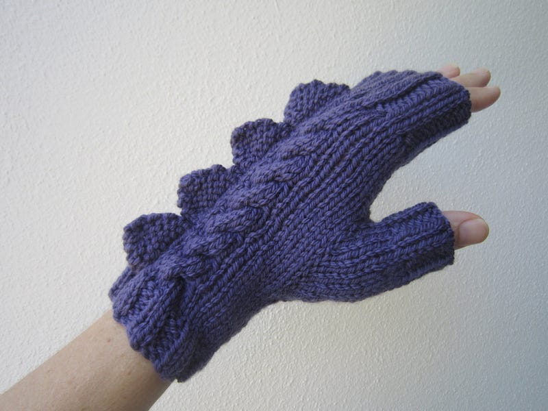 Defend your hands against the cold with these dragon mittens