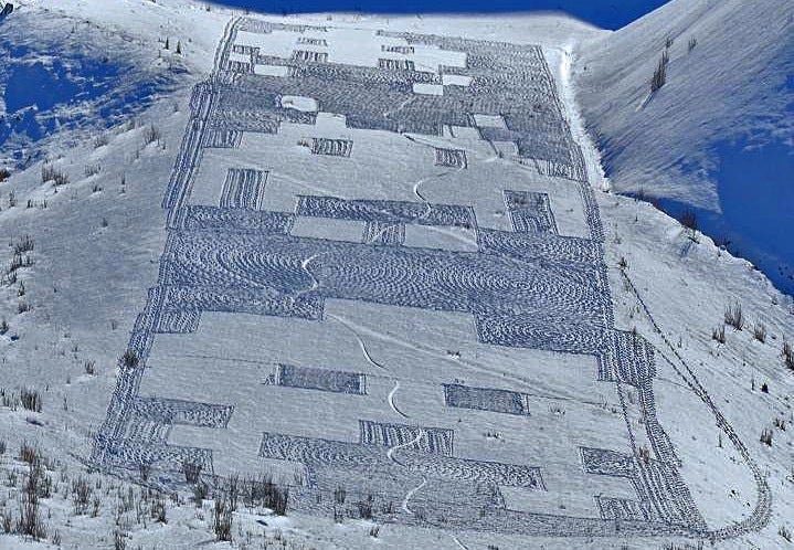 "Snowy Space Invaders ""crop circle"" appears on a French hillside"
