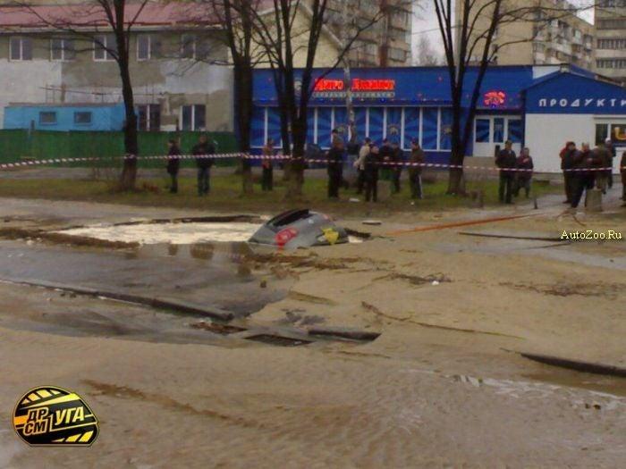 Volkswagen Golf Swallowed By Ukrainian Pothole