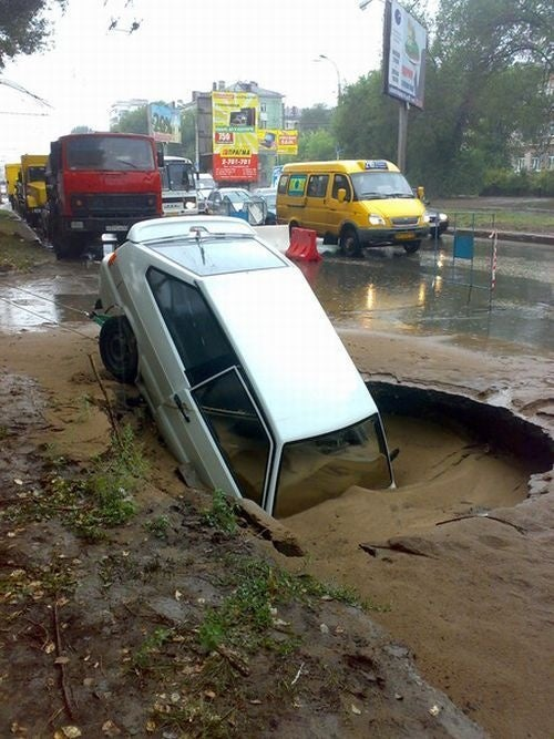Quicksand Plus Pothole Equals Sunken Car