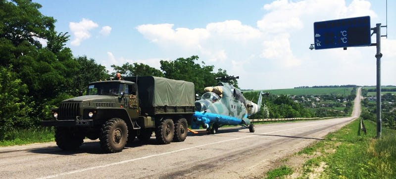 Ukrainian Mi-24 Hind Shot Down, Towed Away By Truck