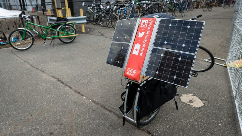 This Apocalypse-Ready Solar Charging Station Folds Up Behind a Bike