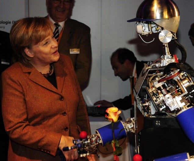 Why Is Angela Merkel Always Palling Around With Robots?