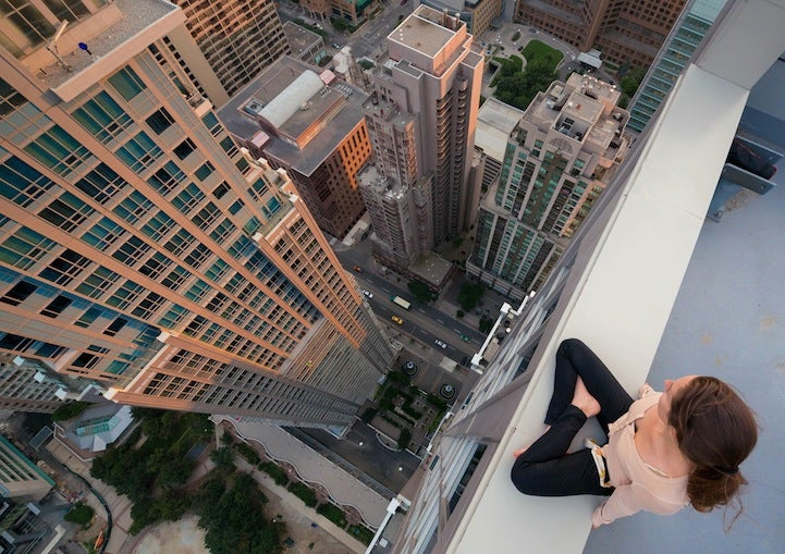 People tip toeing on top of buildings over cities will always be scary