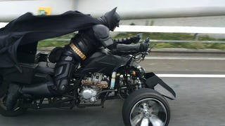 This guy is driving a batcycle around Japan in a perfect Batman costume