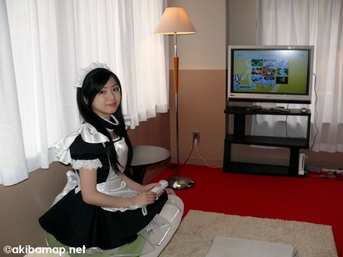 Playing Wii Fit With A Japanese Maid, A Photo Journey