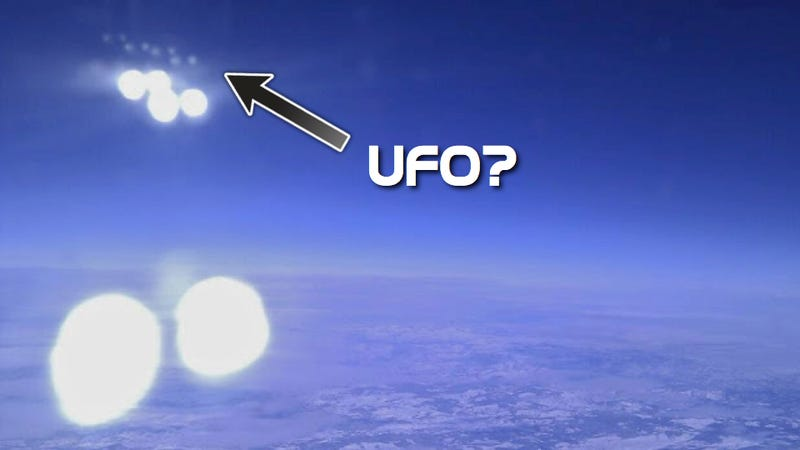 Is this a picture of UFOs shooting laser beams at an airplane?