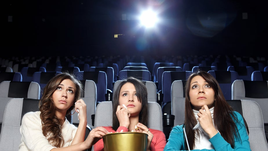 watching a movie in the cinema When you walk into a theater, you're probably still going to argue with your friends about which seat to pick but now you know the right answer.