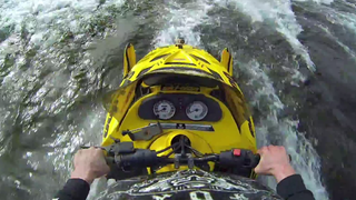 Watch A Guy Ride A Snowmobile Over River Rapids