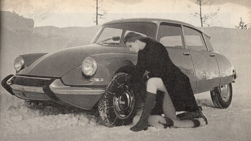 Miniskirt woman installs snow chains on Citroën DS