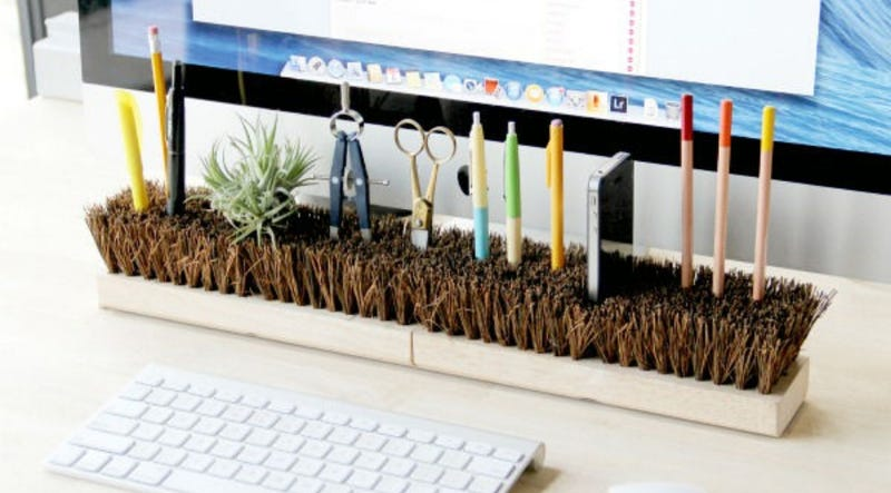 Invert Broom Heads to Organize Your Desk
