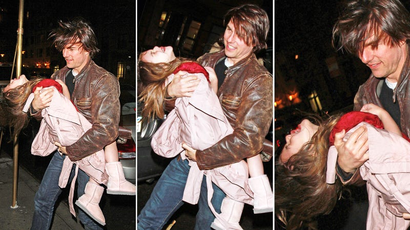 What Is Tom Cruise Doing to Suri in This Picture?