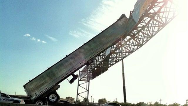 How did a truck crash on top of this Houston freeway sign?