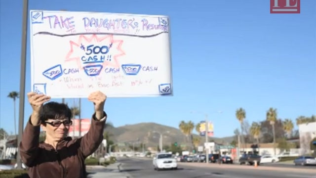 Woman Offers Passing Motorists $500 to Give Her Daughter a Job