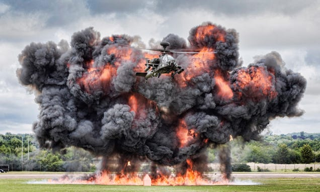 Here's an Apache attack helicopter flying away from a monster explosion