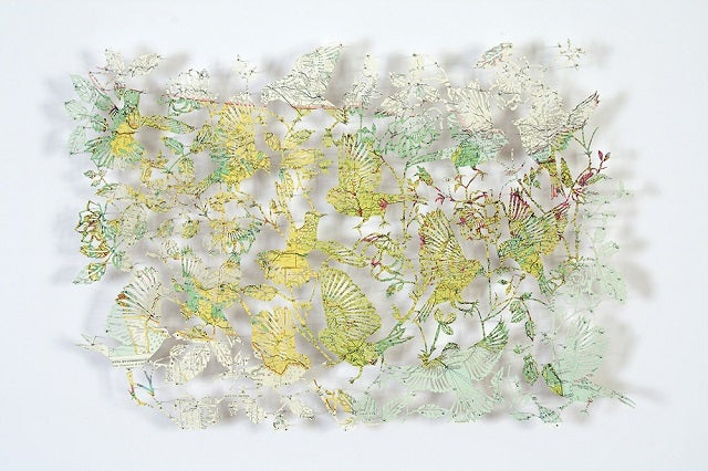 The Astonishing Art of Birds and Flowers Cut From Maps