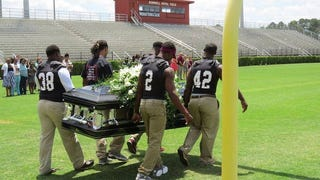 Malik Sparkman died last week from kidney cancer. The 18-year-old's teammates at Coffee (Ga.) High School honored one of his final wishes by carrying his casket through the tunnel and onto the football field.